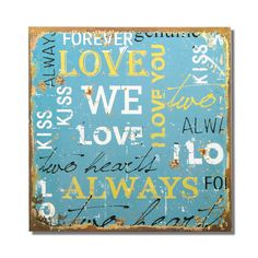 """Furnistar Decorative Wood Wall Hanging Sign Plaque """"Love"""" Word Canvas. Add a splash of color and style to the bedroom kitchen or living room with this sweet bright word collage. Love Kiss two hearts and more adorn this light blue frame in a variety of yellow and white fonts. The collage is bordered by a worn rusted effect that gives this plaque a timeless quality. It complements many decor styles and makes a wonderful housewarming wedding or anniversary gift"""