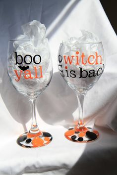 Hey, I found this really awesome Etsy listing at http://www.etsy.com/listing/162954321/2-halloween-wine-glasses-say-boo