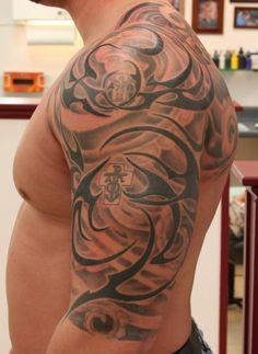 Grey-Anchor-And-Black-Tribal-Tattoo-On-Left-Half-Sleeve.jpg (600×822)
