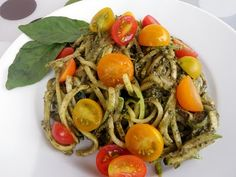 Raw Zucchini Pasta with Pesto - leave out the garlic or sub some lemon juice, sub another veg for the tomatoes if not tolerated