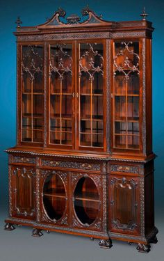 This beautiful Victorian library breakfront is crafted of Cuban mahogany in the majestic Chippendale Revival style, ca 1900