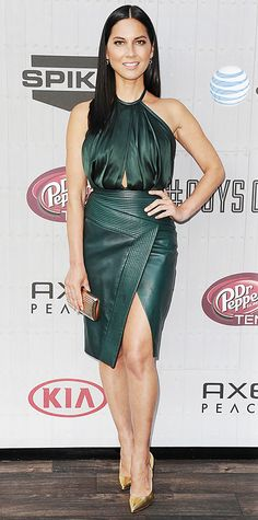 Olivia Munn was radiant at the 2014 Spike TV Guys Choice Award, selecting a rich emerald green silk halter top and asymmetric leather pencil, both by J. Mendel, and accessorizing with a gold clutch, EF Collection jewelry, and gold Brian Atwood pumps.