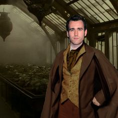 """Neville Longbottom, Herbology, is a pure-blood wizard. His parents were tortured to insanity by Death Eaters leaving Neville to be raised by his """"Gran"""", Augusta Longbottom. He was excited to get a Mimbulus Mimbletonia for his birthday from his great-uncle Algie & had plans to breed it at Hogwarts. He is an expert in Herbology. He led the D.A. during his 7th year in opposition to the Death Eater professors. During the Battle of Hogwarts, he destroyed the final Horcrux when he beheaded Nagini."""