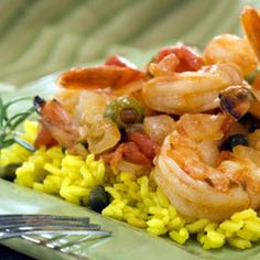 Spicy Spanish Shrimp Recipe Main Dishes with fillet red snapper, i can't believ it' not butter! made with olive oil spread, yellow onion, garlic, crushed red pepper flakes, diced tomatoes, chicken broth, pimento stuffed olives, small capers, rins and drain