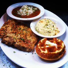 A Monday Favorite at Ma Momma's House of Cornbread Chicken and Waffles- Red Beans and rice seasoned with smoke sausge and served with golden fried 8 oz pork chop, potato salad and cornbread.