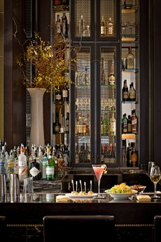 Dream bar..., Ask David if we can add a cabinet such as these in bar.  It would could be created to mirror cabinet around fireplace. Possible tutor diamond leaded glass panel??? Expense??