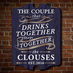 This is not just your ordinary wall art. Our Drink Together Stay Together custom decorative sign is perfect for couples who always enjoy their libations as a pair. Designed with bright lettering and a navy blue wood-grain background, this personalized wall decor features the name and year of your choice. Beautifully handmade from American birch wood with a UV protected finish, this custom decorative sign is perfect as a housewarming gift, wedding present, or to spruce up your own living…