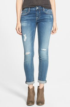 Distressed skinny jeans paired with a relaxed tee and booties is always a go-to for a casual weekend look.