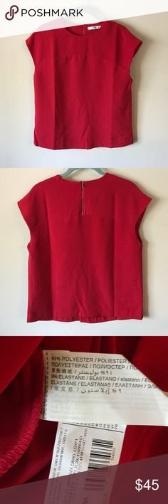 MANGO red top Dressy top. Size 2, but runs big.  No tags, but brand new, never worn. Bought on vacation and was not able to return. Mango Tops