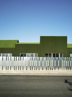 Elementary and Primary Public School in Roldán / Estudio Huma school covered in grass #school Designed by Spanish based architecture firm, Estudio Huma,the school was created with the ideal of teaching from nature. A closer look at the interior of the property reveals a minimalistic look and feel with concrete construction being used heavily throughout. Check out more photos of the Grass Covered School here!