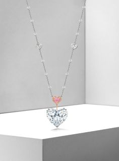 The Heart.  The main stone is a 20.06 carat 'D' flawless type IIA heart-shaped diamond and it is suspended from a fancy vivid purplish pink diamond.  http://www.boodles.com/high-jewellery