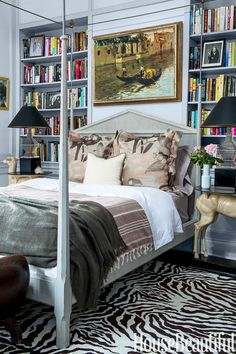 wonderfully eccentric bedroom in New Orleans with funky side tables, zebra rug, art and books