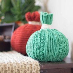 Make a whimsical, colorful, quick and easy no-sew autumn tablescape or centerpiece using extra winter hats and gloves.