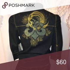 🆕 Dereon Beyoncé Gold Embroidered Jean Jacket 🎗Dereon 🎗Beyoncé Gold Embroidered Jean Jacket. Size is medium but it seems to be a bit smaller than med. Dark wash jean jacket embellished with GOLD metallic DEREON and Fleur-de-lis bling.  Full zip front. Front pockets, 3/4 buttoned sleeves, gathers at shoulders. Zipper front. Gold stitching embroidery and embellishments. 3/4 Sleeves.   Fabric is cotton/spandex.  House of Deréon was a ready-to-wear fashion line introduced by Beyoncé. As of…