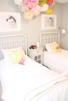 I love this for so many reasons! Beds, colors, dolls, poms, b&w pictures above beds...