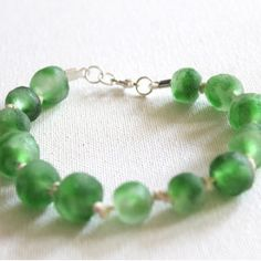 This Green Glass Knotted Bracelet is the perfect frosted hued addition to your red and green ensembles during the Christmas season.