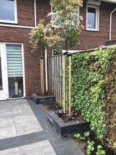 Strakke kindvriendelijke tuin in Veenendaal - Hoveniersbedrijf van den HeuvelHoveniersbedrijf van den Heuvel