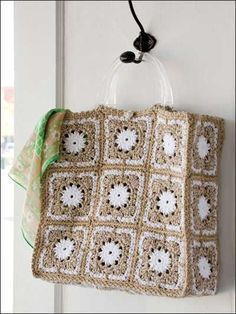 Patchwork Tote - Making this stylish tote is as easy as stitching square motifs. This e-pattern was originally published in the August 2010 issue of Crochet World magazine. Designed by Katherine Eng . Crochet Purse Patterns, Bag Crochet, Crochet Shell Stitch, Crochet Handbags, Tote Pattern, Crochet Purses, Crochet Granny, Crochet Crafts, Crochet Stitches
