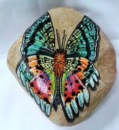 STONEIMALS: This is a beautiful Butterfly ready for someones garden or home.    The painting is done as the insect painted on the rock as if it is