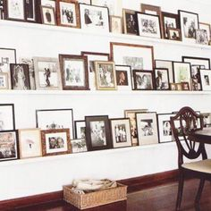 Maybe you are not one for hanging photos…no problem use shelves instead! I love how this is like a library of images.