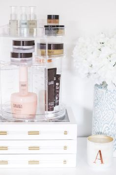 The best Amazon beauty finds - including this clear acrylic rotating beauty organizer that holds all of your makeup, skincare, and beauty products on your vanity. It's under $25, and the shelves are adjustable too! | Orlando, Florida beauty blogger Ashley Brooke Nicholas | #founditonamazon #amazonprime #beauty Amazon beauty under $25, Amazon Prime finds, what to buy on Amazon, Amazon home finds, beauty organization, bathroom organization, bathroom vanity organization, acrylic organizer