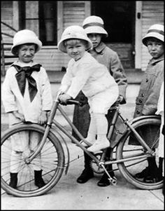 President Gerald Ford (on bike) surrounded by cousins in front of Grand Rapids childhood home, Ca 1915. Photo courtesy Ford Presidential Library (via Presidents And Bicycles | Bike Lane Living)