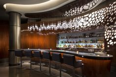 Rosewood Hotel Abu Dhabi, United Arab Emirates. #bar #lighting #design #crystal #glass #red #white #hospitality