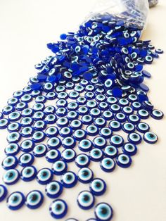 A personal favourite from my Etsy shop https://www.etsy.com/listing/469615080/20-evil-eye-cabochons-6mm-evil-eye-resin