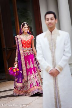 Indian wedding photography. Couple photo shoot ideas. Candid photography. Indian bride wearing bridal lehenga and jewelry. #IndianBridalHairstyle #IndianBridalMakeup