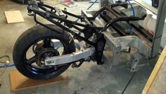 """Now, the two vehicles are bolted together and this is officially a """"three-wheel"""" motorcycle."""
