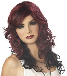 Kick it like a rock star and steal the show in our adult Rock Vixen Burgundy & Black Wig. It will instantly give you a glamorous hairstyle that will have you rockin' the party. Our women's Rock Vixen Wig features two-toned burgundy red and black synthetic hair styled with medium-length layered curly hair that falls past the shoulders and side-swept bangs. The loose curls and layers offer a romantic and stylish appeal. The wig cap is lined with mesh and elastic for a snug and comfortable fit…