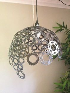Bike gears lampshade- could be fun, cost effective way to update and add life to seasonality in stores More