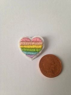 For those who want to express their pride in more dainty shades (or those who just like pastel rainbows). These mini heart badges, 2 cm x 1.5