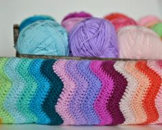 Bright Neat Ripple crochet blanket Stylecraft Special DK yarn:  Apricot, Aspen,  Aster, Candy Floss, Clematis, Fondant, Lavender, Magenta, Petrol,  Pomegranate,  Saffron, Sherbet, Shrimp, Soft Peach, Spring Green, Turquoise, Wisteria.