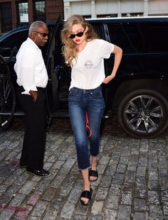 Pin for Later: It Seems Like Every Time We See Her, Gigi Hadid's Rocking a New Pair of Slides And Proved They Were the Perfect Shoe to Pair With Jeans and a Tee 7 For All Mankind's High-Waist Raw Hem Crop Jeans ($199), to be exact.