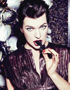 Actress Milla Jovovich shines on the January 2017 cover of ELLE Russia. The brunette stunner poses in a ruffled blouse with a sequined bow embellishment. Tough Woman, The Brunette, Elle Fashion, Hollywood Heroines, Ellen Von Unwerth, Milla Jovovich, Gorgeous Eyes, Most Beautiful Women, American Actress
