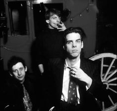 Nick Cave, Mark E. Smith and Shane MacGowan arguing in a pub | Dangerous Minds