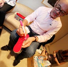 Christian Louboutin signing his iconic red soles.