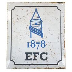A metal home changing room sign bearing a retro Everton logo.
