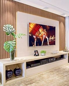 A imagem pode conter: planta e área interna Modern Tv Room, Modern Tv Wall Units, Tv Unit Decor, Tv Wall Decor, Wall Tv, Home Room Design, Home Interior Design, House Design, Home Living Room