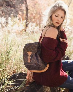 Step your style game up with this Louis Vuitton backpack! 60 day layaway available in time for the holidays (details in our insta story). Shop this mm backpack from the link in our bio. Shop this gorgeous #freepeople sweater @evereveofficial.  @emmylowephoto. #backpack