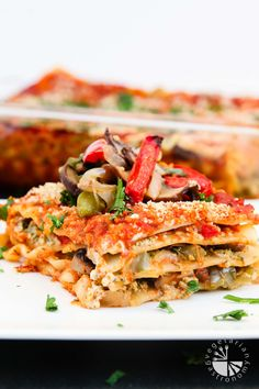 This gluten-free vegan lasagna recipe is rich with oven roasted vegetables, an easy garlic herb tofu ricotta, and some tangy sweet marinara.