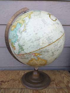 Love! // Check out this item in my Etsy shop https://www.etsy.com/listing/248384223/vintage-replogle-12-inch-world-classics