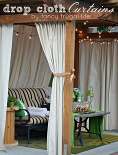 """Cabana"" patio makeover with drop cloth curtains"