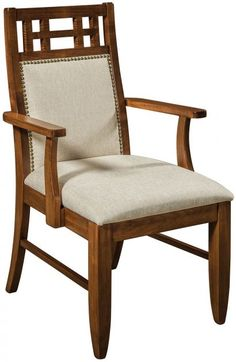 A premium upholstery with warm wood finish set a welcoming scene, while an airy Craftsman headrest on the Magdalena Dining Chair adds visual interest.