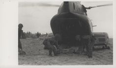 "https://flic.kr/p/BDG4fw | Ammo Lift, HMM-265, 2 January 1968 | ""Ammo Lift: A CH-46 Sea Knight of Marine Medium Helicopter Squadron 265 [HMM-265] is unloaded on the beach by Republic of Korea Marines near Hoi An.  Copters of the 1st Marine Aircraft Wing [1st MAW] moved more than 1,000 Korea Marines from Binh Son to their new base at Hoi An (official USMC photo by Sergeant V. J. Hale, Jr.).""  From the Jonathan Abel Collection (COLL/3611), Marine Corps Archives & Special Collecti..."