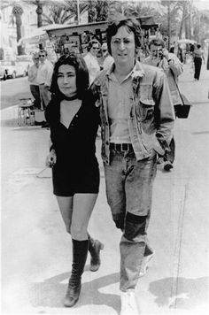 yoko ono / black jumpsuit, knee high boots and choker necklace