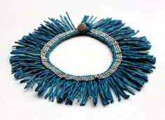 DIY fringe necklace - can you guess what dollar store material this is made from?