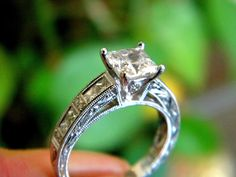 Kirk Kara Engagement ring with a princess cut diamond set in hand-carved white gold.