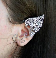 A pair of elf ear cuffs made of silver plated copper wire . The piece is covered by metal protecting laquer. No piercing needed.Another metal(copper, brass) or beads are also possible if you prefer to make some changes in the design.These wire Ears are very comfortable and easy to wear. The hoop adjusts on the back side of the ear, to fit your ear perfectly.